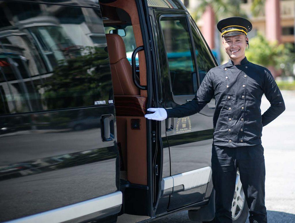 Driver opening the black limousine door